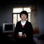 Migrant worker Han Quin in her flat. UNFPA/Guo Tieliu
