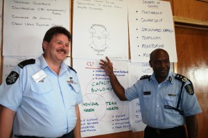RAMSI police adviser, Chris Cooper, and Solomon Islands Assistant Police Commissioner, Eddie Sikua, lead a session during one of RAMSI's Making A Difference capacity development workshops