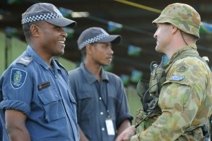 Trooper Trevor Kingston chats to Emmanuel Maepurina from the Royal Solomon Island Police force, prior to the Solomon Islands 32nd Independence Anniversary at Lawson Tama Stadium.
