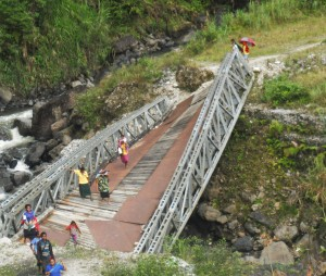 Collapsed bridge cutting off the flow of goods and services
