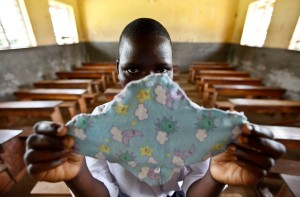 A Ugandan girl holds up a sanitary pad she made in a class at her school. Photo: Echawalu Photography (echwaluphotography.wordpress.com)