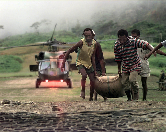 Delivering food aid when there are no roads, PNG 1997 (Flickr/DFAT/Darren Hilder, Aust Defence)