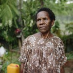 Doris Talban, 51 (maybe older?). Affording and accessing clean water is a struggle for Doris. Marata 2 settlement, Port Morseby, Papua New Guinea.