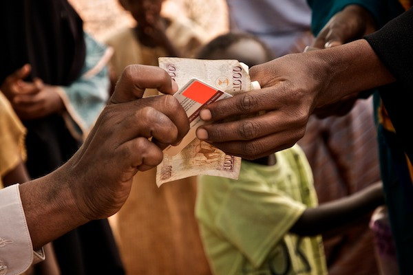 Cash transfer in northeastern Kenya (Flickr/Colin Crowley)