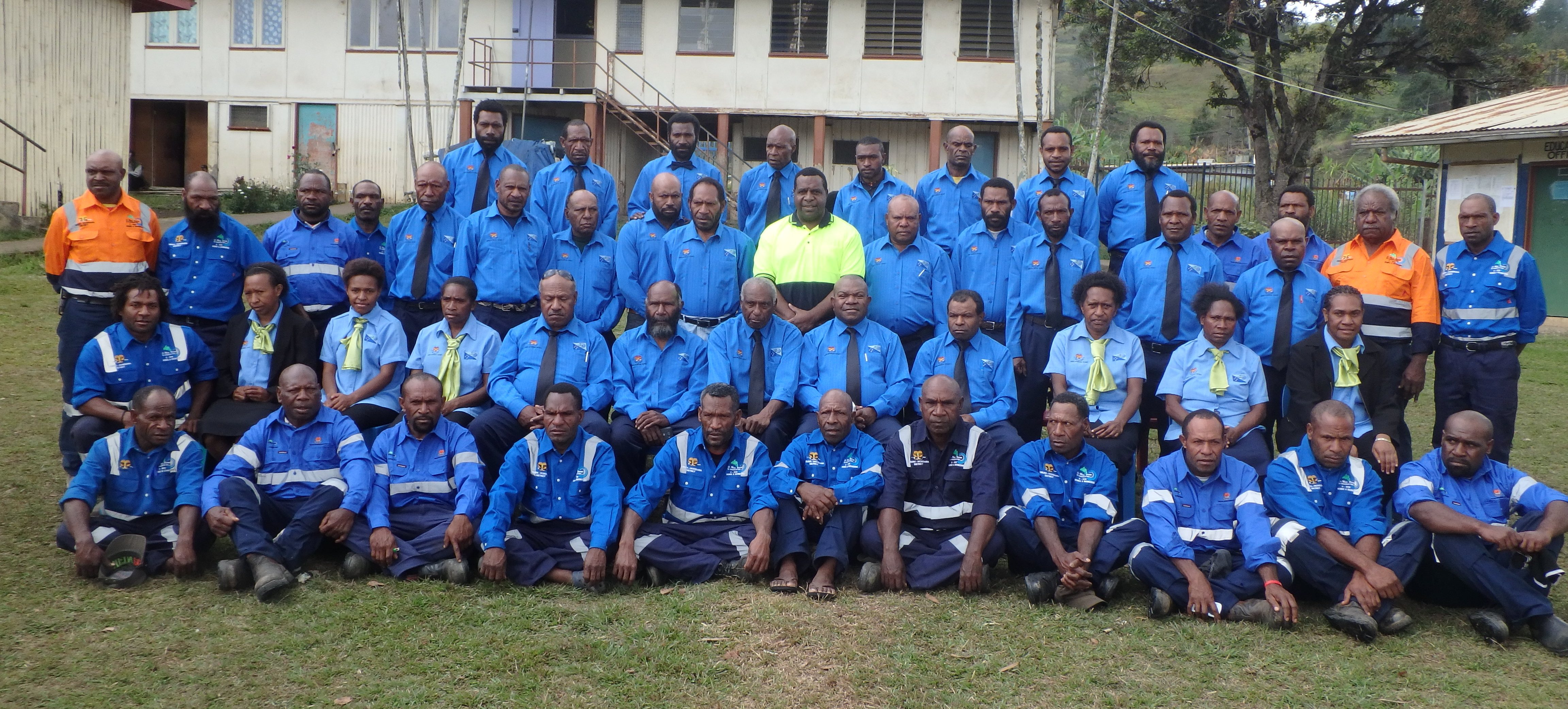 The MP for Obura Wonenara (The Honorable Mehrra Kipefa) [at centre, in high-vis top] with the District Development Authority Board and District Administration Team, in their newly issued uniforms, December 2015 (image: Bennie Atigini, CARE PNG)