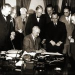 Harry Truman signing the Foreign Assistance Act of 1948