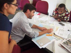 Tara Davda, Colin Wiltshire and Peter Kanaparo examine a map.