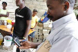 Using mobile phones to deliver aid messages after the earthquake in Haiti (Flickr/DFID/Russell Watkins CC BY-SA 2.0)