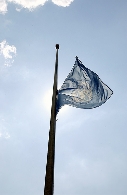 UN flag at half-mast (Flickr/UN Photo/Mark Garten CC BY-NC-ND 2.0)