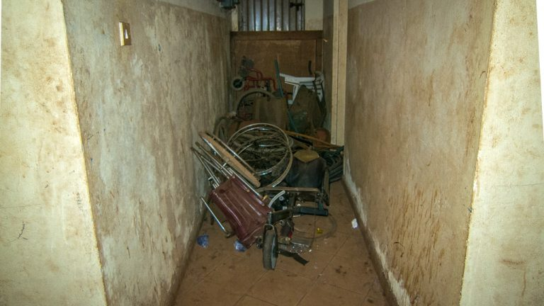 An ad-hoc storeroom for donated and broken wheelchairs, Freetown, Sierra Leone (image copyright Wesley Pryor)