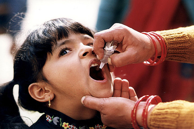 Girl receiving oral polio vaccine (Flickr/CDC Global CC BY 2.0)