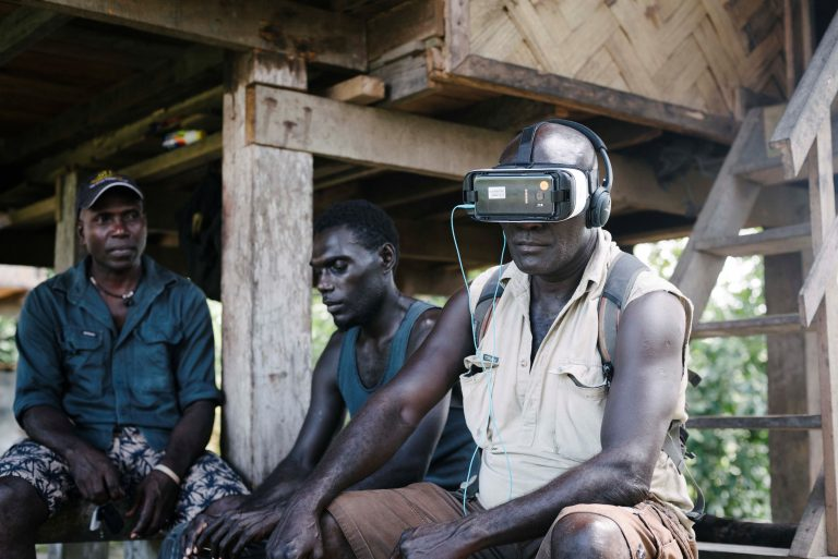 Former Bougainvillean combatant, now cocoa farmer Timothy Konovai tries out VR for the first time (image: World Bank/Alana Holmberg)