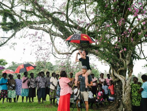 Josh Flavell (The Price of Conflict cinematographer) and Chris Panzetta (Director) set up a 360-degree shot under the bougainvillea in Oria village, Konnou, Bougainville, PNG (image: World Bank/Alana Holmberg)