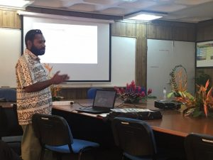 Peter Kanaparo makes a point at PNG's education department (image: Amanda Watson)