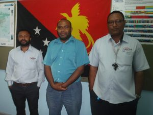Hans Adeg, Gibson Tito and Kila Aluvula at their workplace in Port Moresby