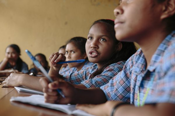 Lucia Pereira, 14, in a classroom at Ailuli Pre-Secondary School in Same, Manufahi District, Timor-Leste (WaterAid/Greenwood)