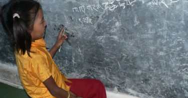 Student at Dawa Dhechen Chhyolin Gumba (Buddhist School), Gaighat Udayapur, Nepal (image: Hilary Smith)