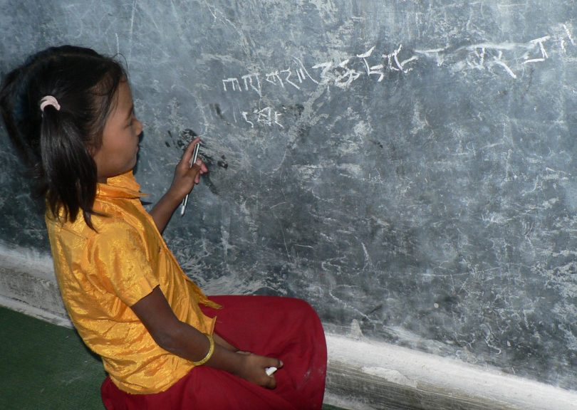 Student at Dawa Dhechen Chhyolin Gumba (Buddhist School), Gaighat Udayapur, Nepal (image: Hilary Smith)