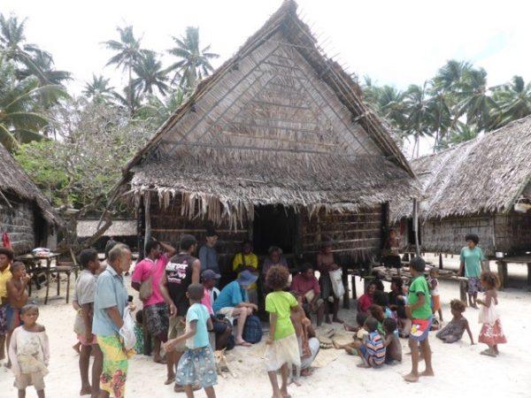 Harry Beran discussing traditional canoes at Wabanum village, Muyuw (Woodlark) Island (image: John Greenshields)