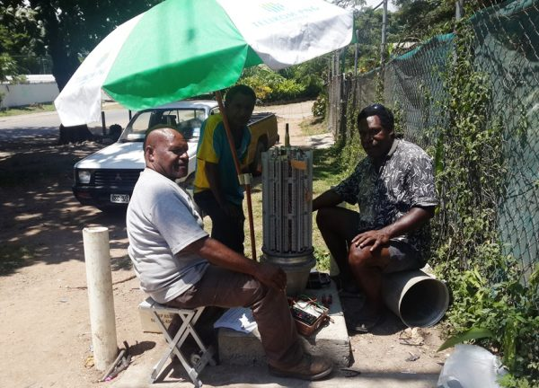 Telikom technicians at work in Port Moresby (image: Telikom PNG)