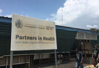 Australian aid sign at the National Referral Hospital, Honiara (Credit: Camilla Burkot)