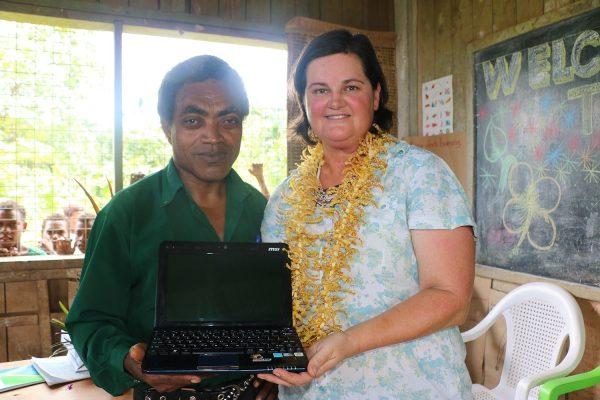 Kerry with the school's Head Teacher, John Maeinua