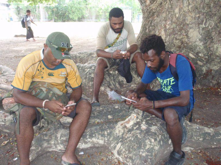 UPNG students using their mobile phones (Credit: Amanda Watson)