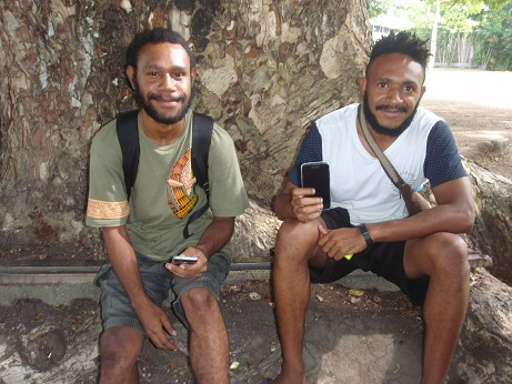 UPNG students with their mobile phones (Credit: Amanda Watson)