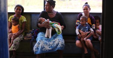 Women wait to have their children vaccinated at the Waima sub-health centre, PNG (Credit: ChildFund)