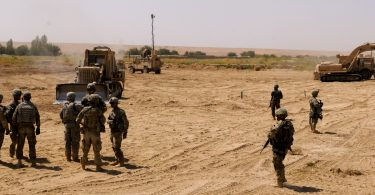 US soldiers and bulldozers clear and improve Route Agha in Afghanistan (Arctic Wolves/Flickr/CC BY 2.0)