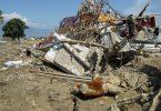 A mud-covered teddy bear lies among a pile of debris following the recent tsunami in Indonesia (Credit: ABC News/Ari Wuryantama)