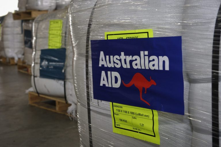 Pallets for AusAid emergency aid supplies are prepared for delivery to cyclone ravaged Fiji (DFAT/Flickr/CC BY 2.0)