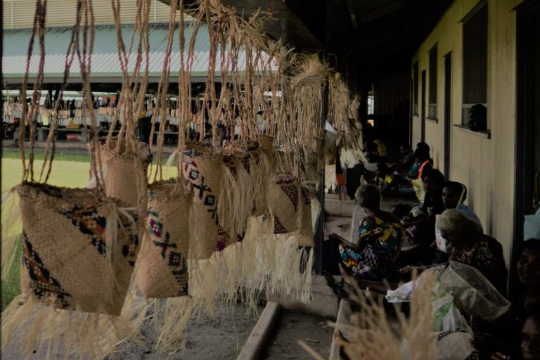 Women weaving baskets at Lorengau market, Manus Island (Credit: Michelle N Rooney)