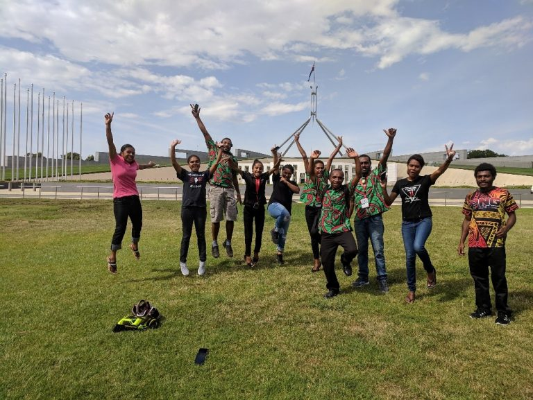 2019 ANU-UPNG Summer School students in front of Parliament House, Canberra (Credit: Ashlee Betteridge)
