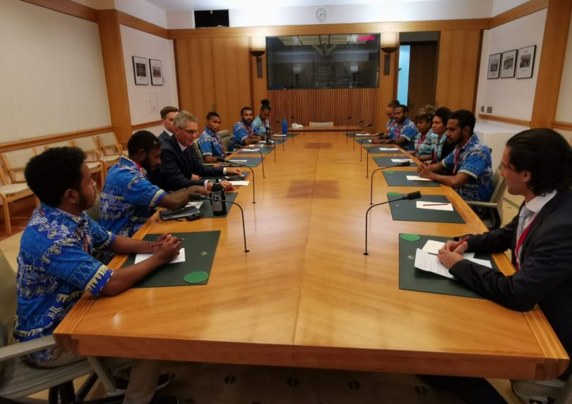 UPNG Summer School students met with Tim Bryson, Senior Adviser to Alex Hawke, Minister for International Development and the Pacific, at Parliament House (Credit: Rohan Fox)