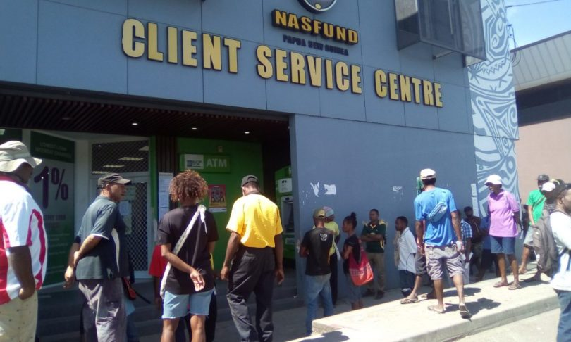The beginning of a very long queue at the NASFUND office, Four Mile, as unemployed people seek early release of their superannuation (Photo credit: Jotam Sinopane)