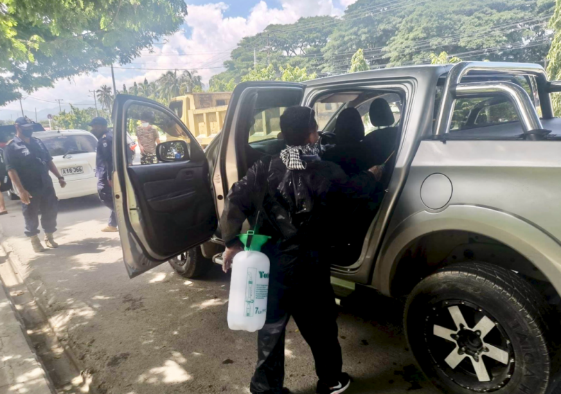 Timorese police disinfect cars in Dili (Credit: Jose Ramos-Horta/Facebook)