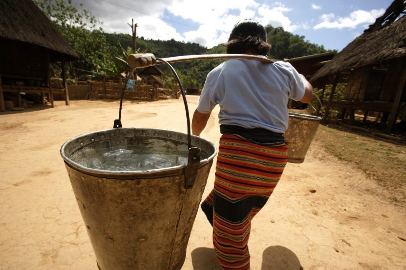 Carrying water in Lao PDR (Credit: DFAT/Flickr CC BY 2.0)