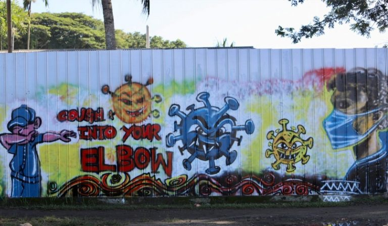 Artwork on the roadside in Madang town in PNG as part of the Madang Provincial Authority's health communication strategy during COVID-19 (Photo credit: Professor Fr. Philip Gibbs)