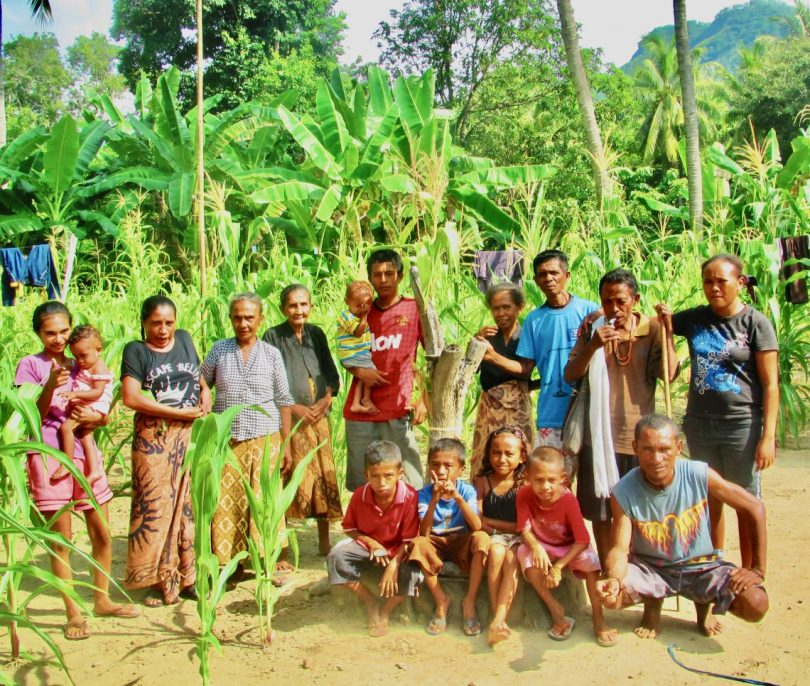 Family from Oecussi, Timor-Leste, gather around the altar they use to pay homage to their ancestors (hau mone) at the feast of the new corn (Michael Rose)