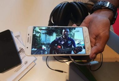 A local guitarist on a mobile telephone screen, Irupara village, Central Province, PNG, 2019 (Denis Crowdy)