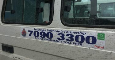 Signage on a police vehicle in Lae (Judy Putt)