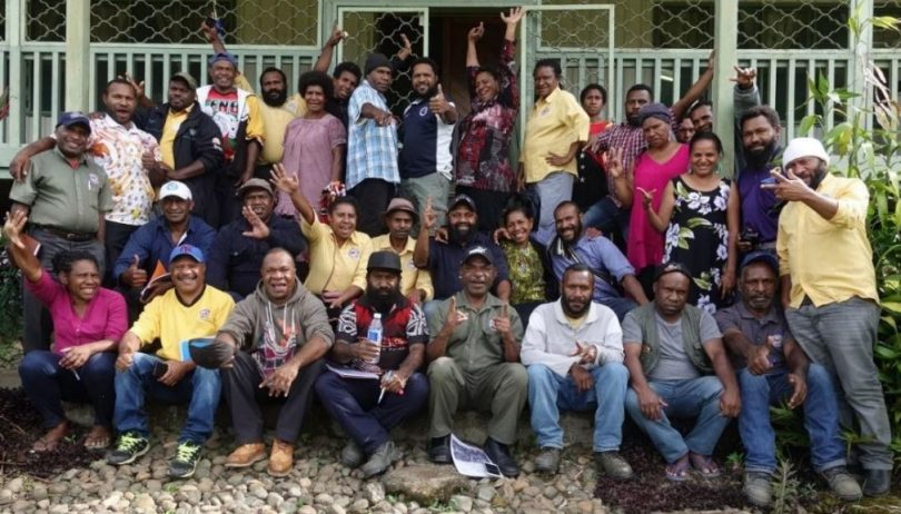 Extension officers from Coffee Industry Corporation and leaders from farmer groups attending strongim grup training in Aiyura, December 2019 (image supplied by the authors).