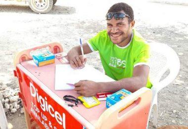 Nigel Uyam operating a registration booth in Basamuk, Madang Province, September 2020