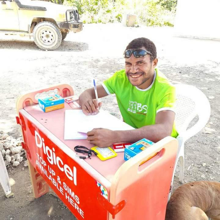 Nigel Uyam operating a registration booth in Basamuk, Madang Province, September 2020