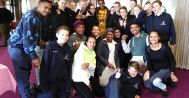 Timorese workers with friends from the local parish school in Warrnambool.