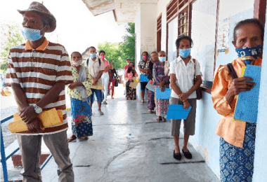 People queue outside the cash distribution centre at Suco Dato, Liquica Municipality, Timor-Leste