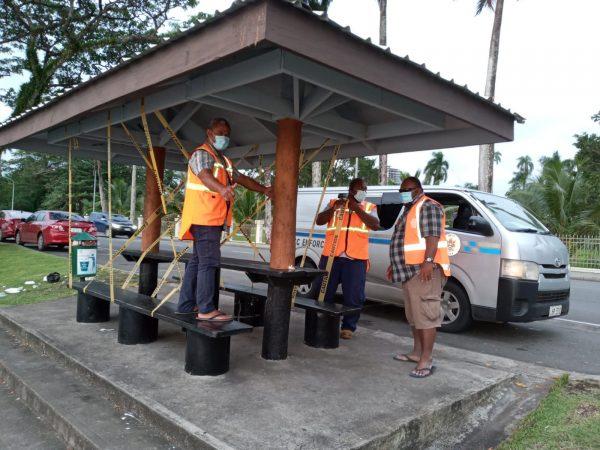 Suva City council workers cordon off park seats to help prevent community transmission (Credit: Sadhana Sen)