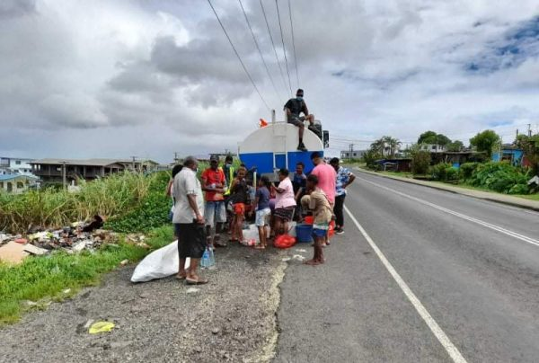 While Fijians told to wash hands, children and adults fill water containers from a water truck along the Suva-Nausori corridor for their daily needs due to water cuts (Credit: Sadhana Sen)