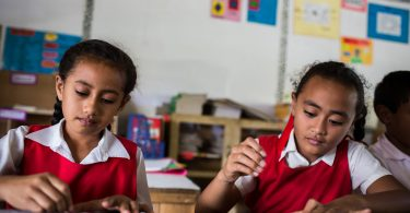 Students learning in a Tongan government school